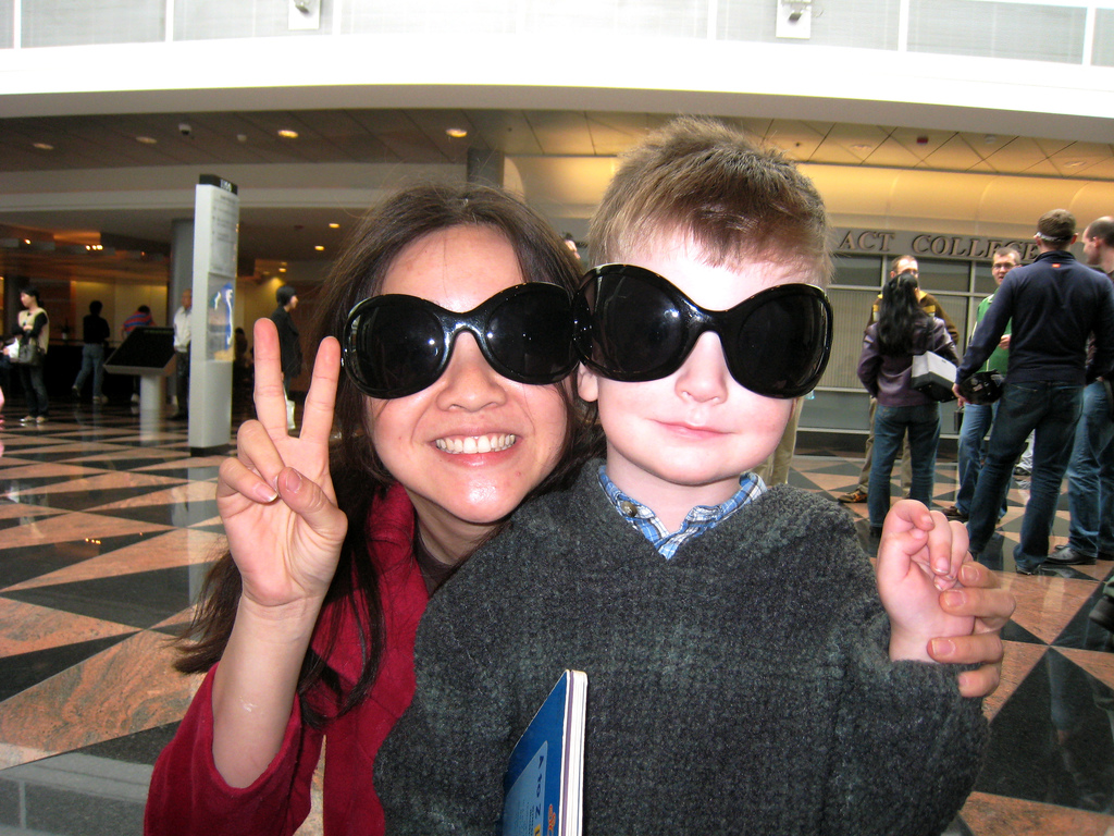 Cindy Li and Brian posing with silly glasses